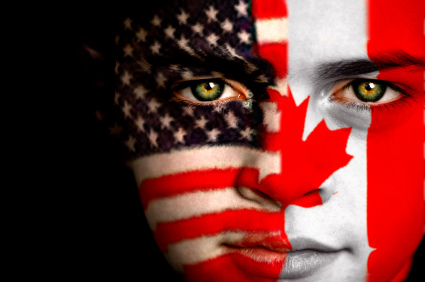 Face painting with American flag on one side of face and Canadian flag on the other.